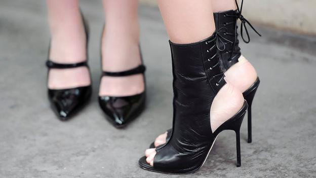 Models wear shoes by Spanish fashion designer Manolo Blahnik at a central London venue.